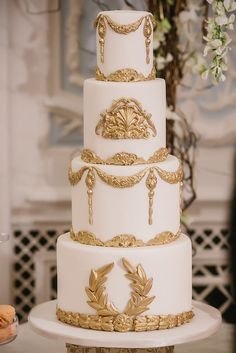 White and gold baroque wedding cake