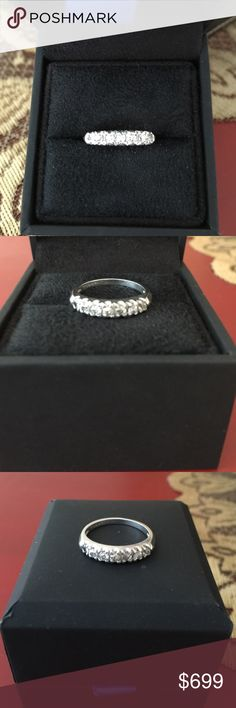 PLATINUM 7 STONE DIAMOND BAND PLATINUM 7 stone diamond wedding band.  Antique fishtail style.  Ring is appraised at $1000***HAVE APPRAISAL FROM JEWELER DIAMOND DISTRICT DWTN NYC*** Jewelry Rings
