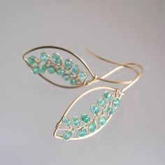 .........everyday in green.......... Made to order with a two week turnaround. 20 gauge 14k gold filled wire lengths were hand forged into leaf style earrings. Adorned with wire wrapped vines of emeralds..which are an aqua green. Finished length is just under 1 3/4. Thank you, Tracey