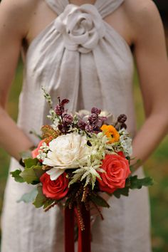 Other bouquet I am in love with....and this one will match the season/wedding party colors better!