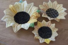 Sunflower Bowls made with heat activated batting -- apparently, heat makes it get somewhat stiff but it is still a bit flexible.