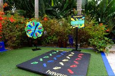 A modified Twister board replaced the game's classic colored circles with Havaianas flip-flops at a promotion for the brand at Miami's Shore Club in 2009.  Photo: Seth Browarnik/Red Eye Productions