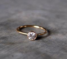 Moissanite diamond ring in 14k setting. 632 via Etsy.