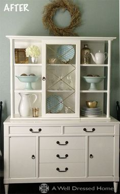 Dated looking hutch - cabinet painted white.