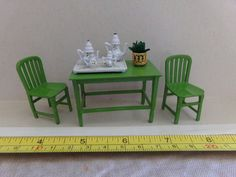 vintage doll house table and chairs.  Tootsie Toy brand. cast metal #TootsieToy