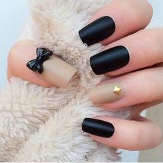 Nude and black matte nails