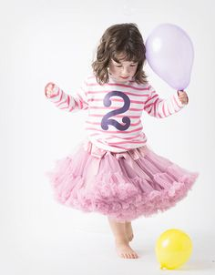 Alma wears Candy Bow Tutu in Wild Rose. Available to buy now at www.our-kid.co.uk