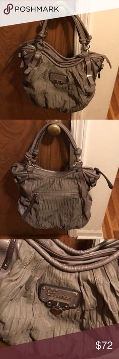 Grey Giada Guess Bag Grey Giada Bag - Faux Patent Leather  Excellent Condition- Only used once Rouched pebble vinyl exterior  Heart shaped emblem w/ script logo on front Zipper Top Closure  Interior & Exterior Pockets Guess Bags