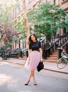 Pink tulle skirt and a black crop top…