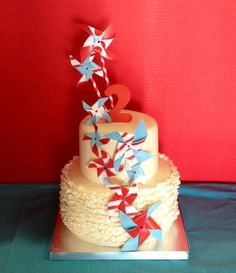 ruffled pinwheel carnival birthday cake