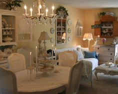 Small shabby chic living room with dining area incorperated. Lovely.