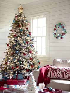 Whatever your style or budget, your Christmas tree is the centerpiece of your holiday decorating plans. Shop ornaments and more at Lowe's today. #holiday #flocked #inspiration #homedecor