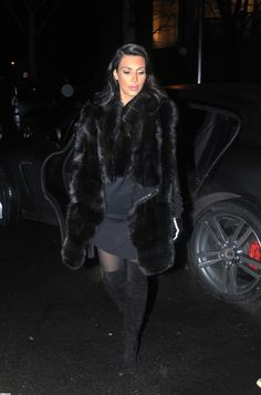 Kim Kardashian looked majorly luxe in a black #furcoat and black suede over-the-knee boots during a night out in Paris.