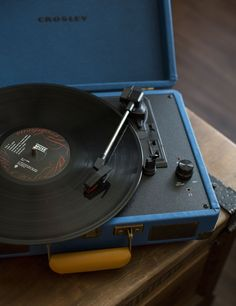 Spin your favorite LPs in this vibrant blue, vintage-inspired briefcase. Ready to party at a moment's notice, this portable 3-speed turntable is easy to carry and comes with modern conveniences, such as MP3 or external audio connections, clear & dynamic stereo speakers, RCA outputs, and a headphone jack for personal listening. #earthboundtrading #vinyl #recordplayer #music
