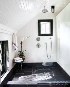 The master bath is sheathed in slate floor tiles, and the towels are by Olatz.