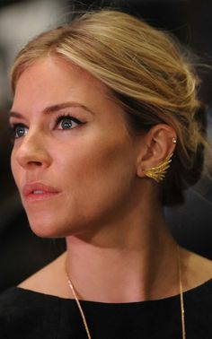 My newest obsession: Sienna Miller's gold winged earring studs. These are such a graceful statement piece without overpowering the face or hairstyle. I am on a mission to find these fantastic studs...