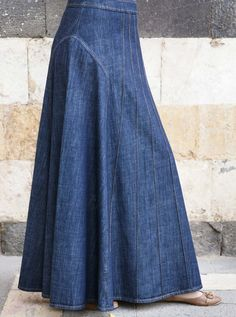This flared pintucked denim skirt is a staff favorite. The elegant lines and stitching make for a slenderizing silhouette, and the different denim washes can easily be matched with anything. Stylish and flattering, pair it with any of our tunics, tops, or blouses.