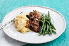 Tender chicken cooked with olives is perfectly complimented with green beans and polenta.