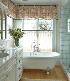 Bathroom windows- half semi sheer pleat curtain with a dark rod mounted inside window frame.