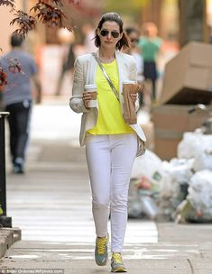Caffeine fix: The 31-year-old Oscar winner paired her electric-hued top with a white blaze...