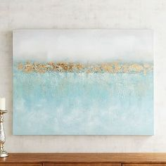 Deep blues. Soft grays. Gold-leaf textures. Our abstract painting offers a calming vibe to any room, whether hung over your bed, featured in your living room or propped atop your mantel.