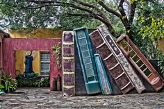 """A wall of books by Craig Strachan, via Flickr. Literally, a wall of books. This wall was spotted at a wonderful guest house, """"The Rabbit Hole"""", in Klerksdorp, South Africa"""