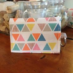 Wallet keychain - Etsy find! White with colored triangles. Fabric key chain wallet.  Plenty of room to store cash and cards. Velco opening, stays secure. Etsy Bags Wallets