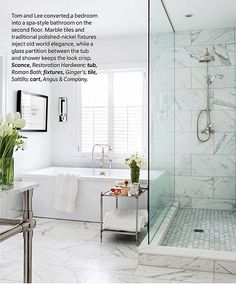 Love this shower but I am picturing it with white subway tiles on the walls and wood looking titles on the floor