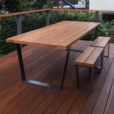 ULTIMATE OUTDOOR SETTING A 3.3cm thickness black butt, spotted gum or Jarrah table top with powder coated stainless steel or aluminium loop legs. Powder coated to any colour. (Table in photo is Blackbutt)