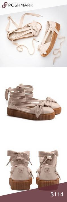 """PUMA FENTY Rihanna Bow Creeper Sandals Flats A twist on the beloved classic Creeper from Rihanna's inaugural footwear drop for PUMA. This Creeper Bow Sandal creates an espadrille style look with the laces and bow details. Also, you can lace your Creeper Bow Sandals all the way up your ankle.  • New With Tags • From a Smoke Free & Pet Free Home  SIZE • 7  DETAILS • Gum Creeper Sole • Soft Leather Upper with a bow • Long Sneaker Laces for a wrap-around-the-ankle closure • 30 """" length from toe…"""