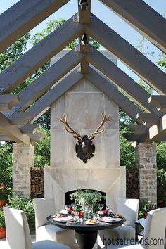 outdoor living spaces Rough-sawn cedar beams arch dramatically over this terrace, which includes a striking limestone fireplace, to create an enchanting outdoor dining area in Powell. Design: Landfare Ltd.CBS Outdoor CBS Outdoor may refer to: Outdoor Rooms, Outdoor Dining, Outdoor Decor, Dining Area, Outdoor Living Spaces, Outdoor Stone, Indoor Outdoor, Outside Living, Pergola Plans