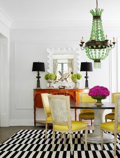 A graphic rug lends lightens the load of a heavy pedestal table paired with French chairs upholstered in yellow leather and backed with faux crocodile. - Photo: Werner Straube / Design: Christine Hughes