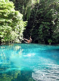 Swimming at one of Vanuatu's famous 'blue holes', Mavutor River, Espirito Santo Island (by Roderick Eime)