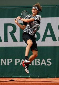 PARIS, FRANCE - MAY 26: Alexander Zverev of Germany hits a backhand during the Men's Singles second round match against Pablo Carreno Busta and David Marrero of Spain on day five of the 2016 French Open at Roland Garros on May 26, 2016 in Paris, France. (Photo by Julian Finney/Getty Images