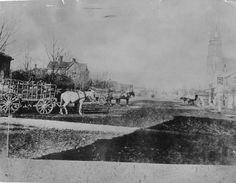 A view of Queen's Avenue looking east from the London Club. Queen's Ave was then called North Street, the building on the left is the Anglican Rectory, on the right is the North Street Methodist Church, 1875. (London Free Press files)