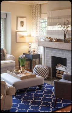 Great idea for living room: nesting tables as end tables. You can pull out smaller tables to put next to a chair that doesn't have a table
