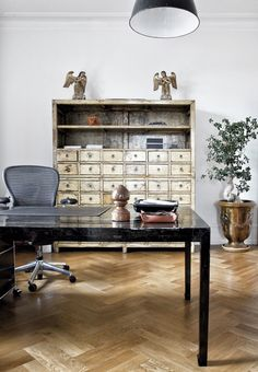 Eclectic home office with a mix of modern and antique interior.