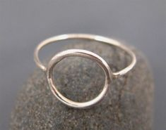 This simple sterling circle ring can also be called an eternity or karma ring. The entire ring is made of thin sterling silver wire and polished to make it nice and shiny. The circle ring is very chic…MoreMore  #JewelrySilver