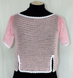 A personal favorite from my Etsy shop https://www.etsy.com/listing/91211818/pink-crochet-top-women-cover-up-cotton