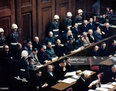 Defendants (in the two central rows) in the dock in Room 600 at the Palace of Justice, during proceedings against leading Nazi figures for war crimes at the International Military Tribunal (IMT), Nuremberg, Germany, 1946. Front row, left to right): Hermann Goering, Rudolf Hess, Joachim von Ribbentrop, Wilhelm Keitel, Alfred Rosenberg, Hans Frank, Wilhelm Frick, Julius Streicher, Walther Funk and Dr. Hjalmar Schacht. Back row, left to right): Karl Donitz, Erich Raeder, Baldur von Schirach…