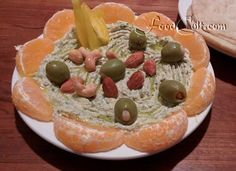 #healthy #vegan #snacking #MiddleEastern style: #Homemade #hummus, #sweet yellow #BellPepper slices, #raw #almonds, #roasted #cashews, #almond and #garlic #stuffed #olives, a ring of #minneola #orange wedges, and a drizzle of #OliveOil.   On the side: #fresh #organic #home #made #pita. Recipes @ FoodCult.com