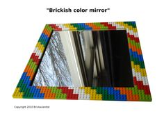 Lego mirror for children's bathroom. Can affix  more Lego decor to this, but be sure the mirror is REALLY well secured, i.e. plastered to the wall, if children will be 'playing' with it.    Can leave chalk pens for note writing on mirror, and Lego decor for the border