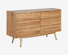 Scandinavian Designs - The epitome of Scandinavian design, the Bolig double dresser is a perfect union of form and function. Six large drawers are housed in clean lines and elevated with angled legs. Crafted from solid American poplar wood in a natural, rustic finish. Sorry, not available in our Colorado stores.