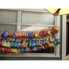 For backyard barbecues!! Cloths pin bags of chip on strings that you hung from one wall to another