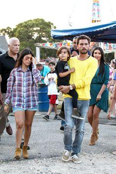 Kourtney Kardashian and Scott Disick take their son Mason to an amusment park in Southampton, New York on July 1, 2014