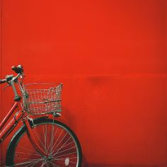 red bike, red wall