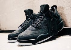 e9eeac63ead749 Rumors suggest we see the KAWS x Air Jordan 4 Black release on Cyber Monday