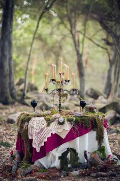 dark fairy tale tablescape in the woods for a Halloween wedding
