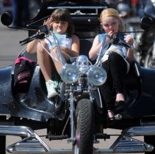 Hannah Vaughn, 10, and Sydney Newton, eight, sit on a Rewaco Trike at the Essex Air Ambulance event at the Weston Homes Community Stadium for the launch of the 2013 Motorcycle Run