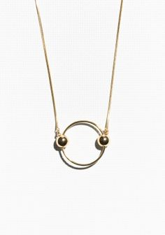 Opt for a layered jewellery look with this long pendant necklace, featuring orb details and a high-shine finish.